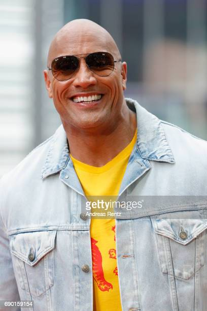 Dwayne Johnson poses at the 'Baywatch' Photo Call at Sony Centre on May 30 2017 in Berlin Germany