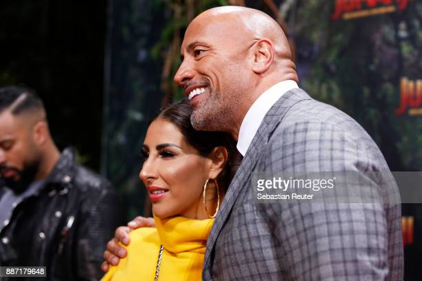 Dwayne Johnson poses with Senna Guemmour as they arrive for the German premiere of 'Jumanji Willkommen im Dschungel' at Sony Centre on December 6...