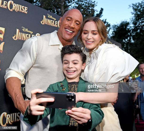Dwayne Johnson, Raphael Alejandro, and Emily Blunt arrive at the world premiere for JUNGLE CRUISE, held at Disneyland in Anaheim, California on July...