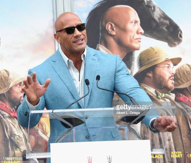 Dwayne Johnson speaks at Kevin Hart's Hand And Footprint Ceremony At the TCL Chinese Theatre IMAX held at TCL Chinese Theatre on December 10, 2019 in...