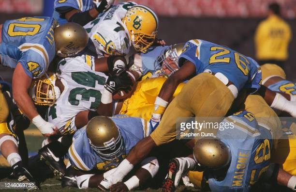 Dwayne Jones, Running Back for the University of Oregon Ducks is tackled by the University of California, Los Angeles UCLA Bruins defensive line...