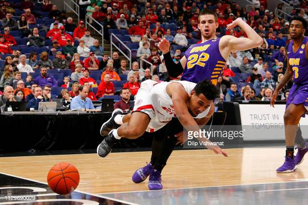Dwayne LautierOgunleye of the Bradley Braves loses control of the ball while driving against Wyatt Lohaus of the Northern Iowa Panthers during the...