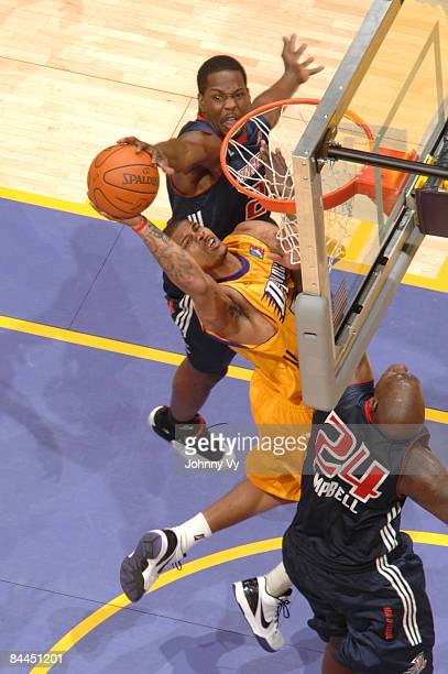 Dwayne Mitchell of the Los Angeles DFenders has his shot blocked by Kedrick Brown of the Anaheim Arsenal at Staples Center on January 25 2009 in Los...