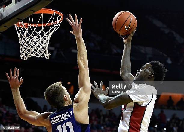 Dwayne Morgan of the UNLV Rebels shoots over Vladimir Brodziansky of the Texas Christian University Horned Frogs during the Global Sports Classic...