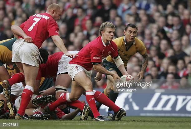 Dwayne Peel of Wales passes the ball away from a ruck during the Invesco International match between Wales and Australia at the Millennium Stadium on...