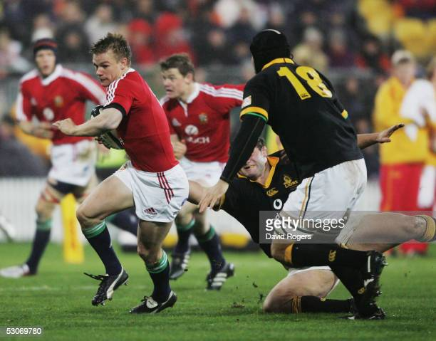 Dwayne Peel the Lions scrumhalf charges forward during the match between the British and Irish Lions and Wellington at The Westpac Stadium on June 15...