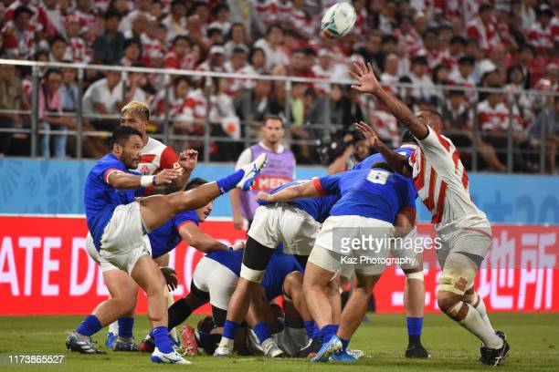 Dwayne Polataivao of Samoa kicks the ball while Michael Leitch of Japan blocks during the Rugby World Cup 2019 Group A game between Japan and Samoa...