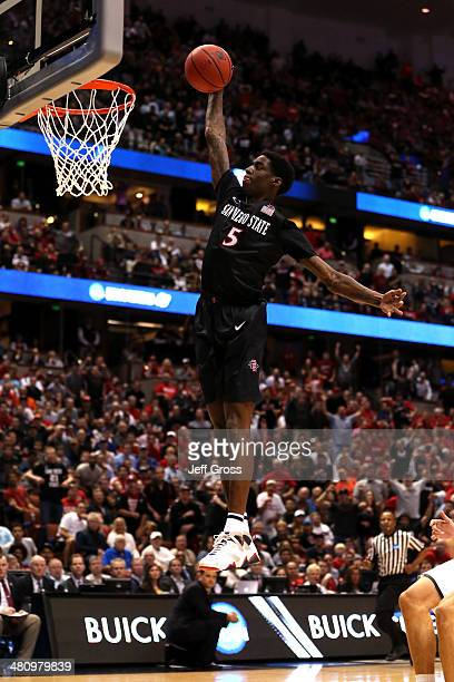 Dwayne Polee II of the San Diego State Aztecs dunks the ball after a steal in the first half while taking on the Arizona Wildcats during the regional...