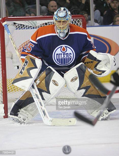 Dwayne Roloson of the Edmonton Oilers eyes the puck against the Calgary Flames at Rexall Place on March 3 2007 in Edmonton Alberta Canada The Flames...
