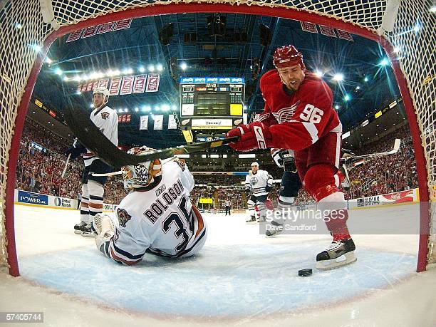 Dwayne Roloson of the Edmonton Oilers lies on the ice after being beat by Henrik Zetterberg of the Detroit Red Wings and Tomas Holmstrom also of the...