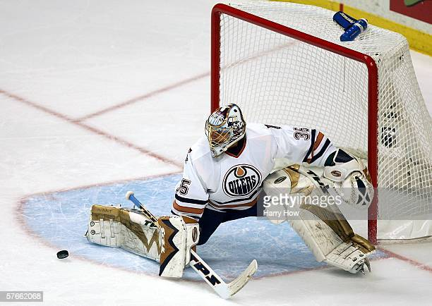 Dwayne Roloson of the Edmonton Oilers makes a leg pad save on a bouncing puck against the Mighty Ducks of Anaheim in game one of the Western...