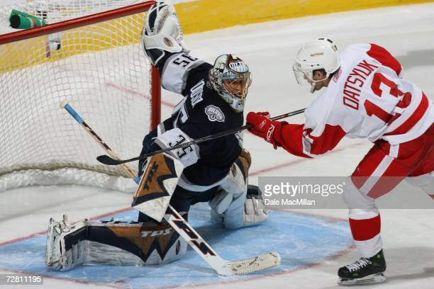 Dwayne Roloson of the Edmonton Oilers makes a save against Pavel Datsyuk of the Detroit Red Wings at Rexall Place on November 18 2006 in Edmonton...
