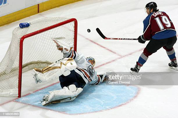 Dwayne Roloson of the Edmonton Oilers stops the sudden death shot by Joe Sakic of the Colorado Avalanche during the game on March 26, 2006 at Pepsi...