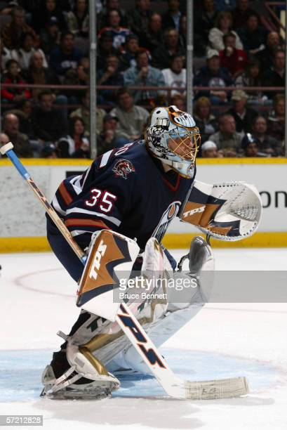 Dwayne Roloson of the Edmonton Oilers tends goal against the Minnesota Wild on March 28 2006 at Rexall Place in Edmonton Alberta Canada The Wild won...