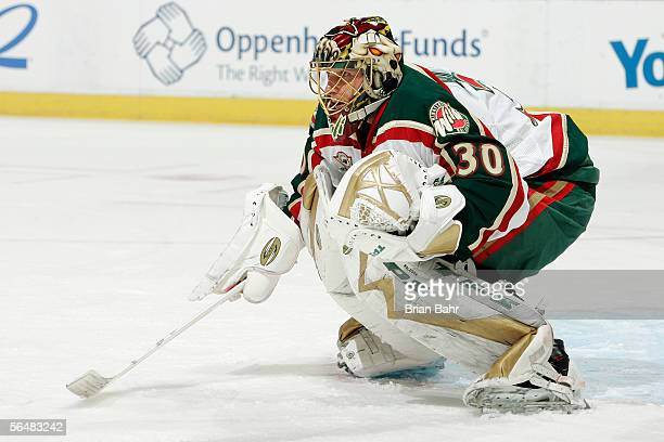 Dwayne Roloson of the Minnesota Wild watches a face-off against the Colorado Avalanche in the first period on December 22, 2005 at the Pepsi Center...
