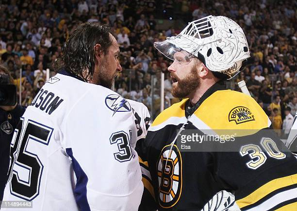 Dwayne Roloson of the Tampa Bay Lightning congratulates Tim Thomas of the Boston Bruins after the Bruins defeated the Lightening 1 to 0 in Game Seven...