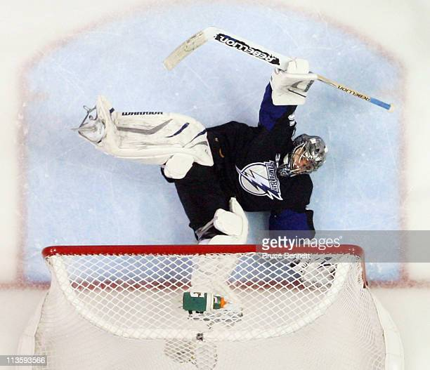 Dwayne Roloson of the Tampa Bay Lightning defends the net against the Washington Capitals in Game Three of the Eastern Conference Semifinals during...