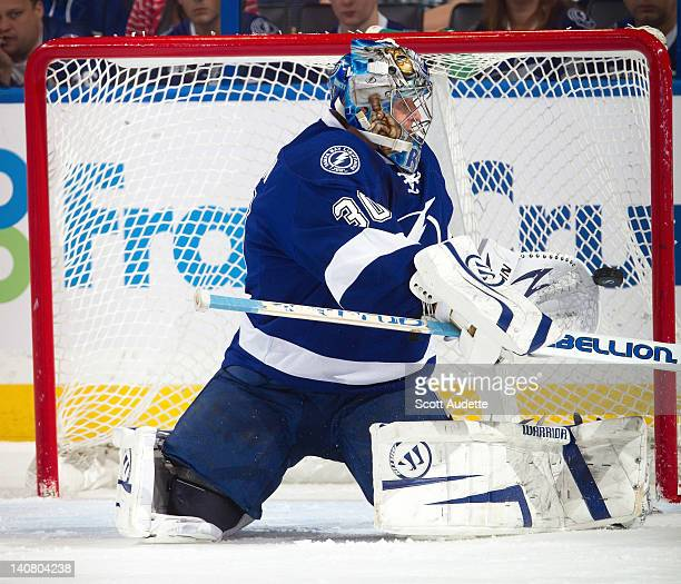 Dwayne Roloson of the Tampa Bay Lightning is unable to make a glove save against the Ottawa Senators during the first period at the Tampa Bay Times...
