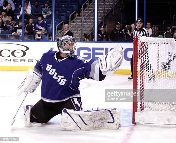 Dwayne Roloson of the Tampa Bay Lightning makes a glove save against the Atlanta Thrashers at St Pete Times Forum on January 23 2011 in Tampa Florida