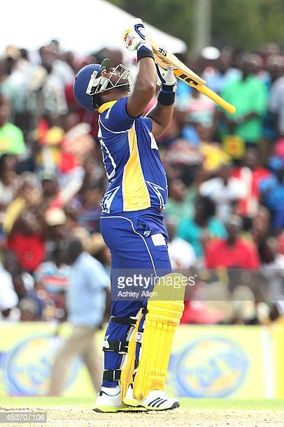 Dwayne Smith celebrates reaching his 50 during the Limacol Caribbean Premier League 2014 final match between Guyana Amazon Warriors and Barbados...