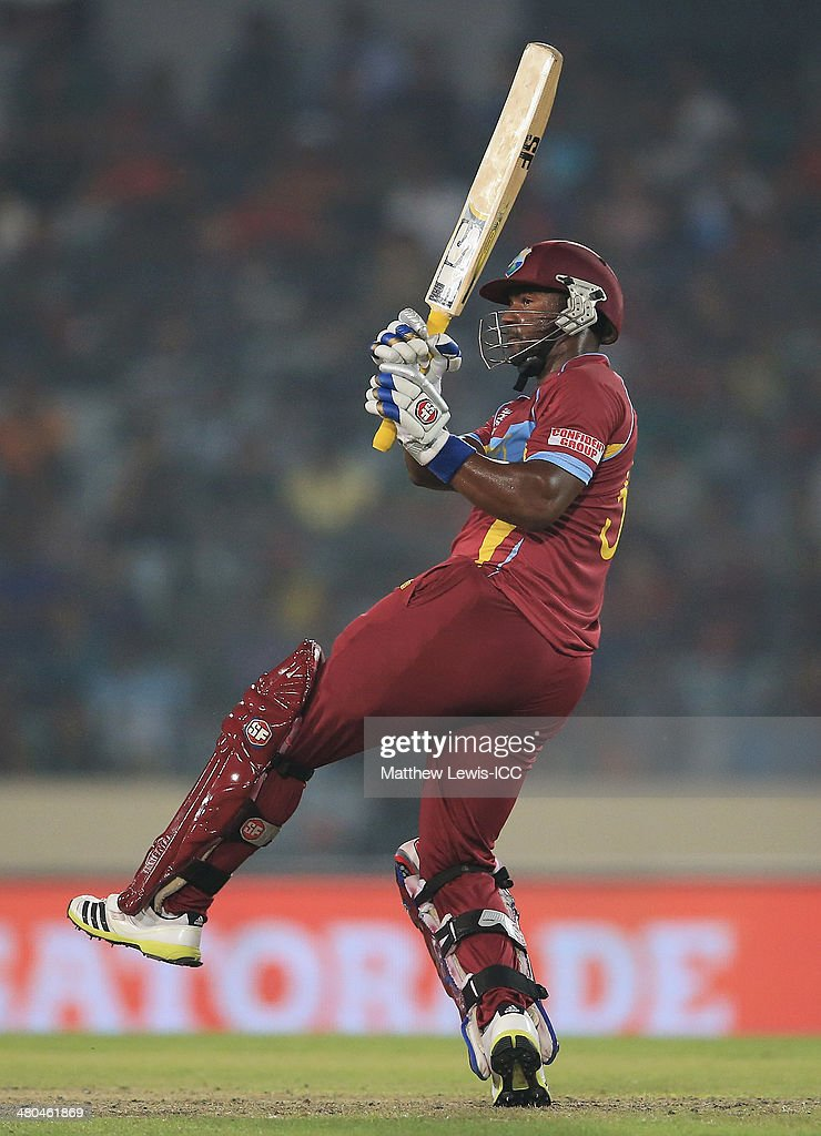 Dwayne Smith of the West Indies pulls the ball towards the boundary during the ICC World Twenty20 Bangladesh 2014 match between Bangladesh and the West Indies at Sher-e-Bangla Mirpur Stadium on March 25, 2014 in Dhaka, Bangladesh.
