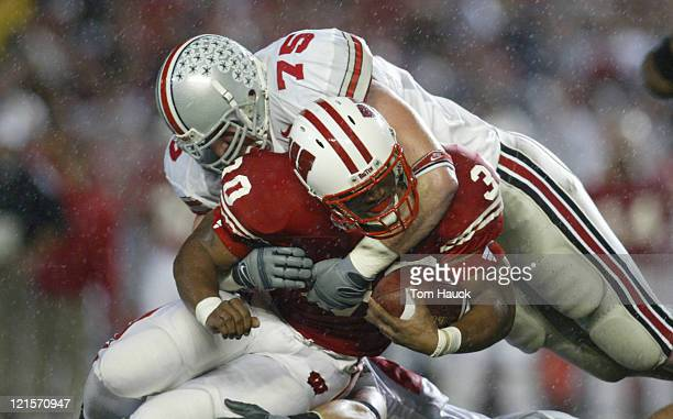 Dwayne Smith of the Wisconsin Badgers touchdown is tackleed by Simon Fraser of the Ohio State Buckeyes at Camp Randall Stadium in Madison Wisconsin