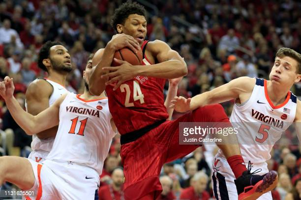 Dwayne Sutton of the Louisville Cardinals rebounds the ball in the game against the Virginia Cavaliers during the first half at KFC YUM Center on...