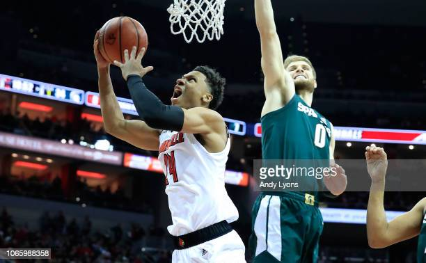 Dwayne Sutton of the Louisville Cardinals shoots the ball during the 8278 OT win over the Michigan State Spartans at KFC YUM Center on November 27...