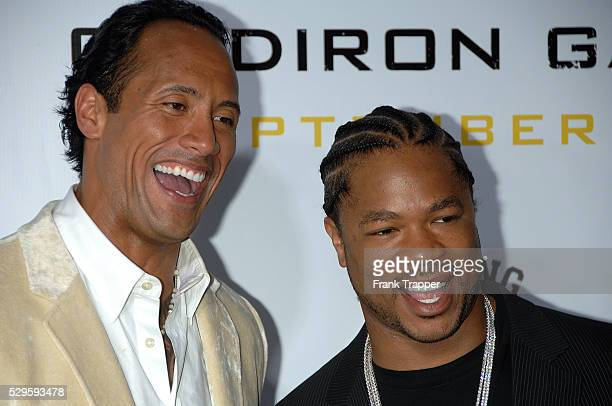 Dwayne 'The Rock' Johnson and Alvin 'Xzibit' Joiner arrive at the premiere of 'Gridiron Gang' held at Grauman's Chinese Theatre in Hollywood