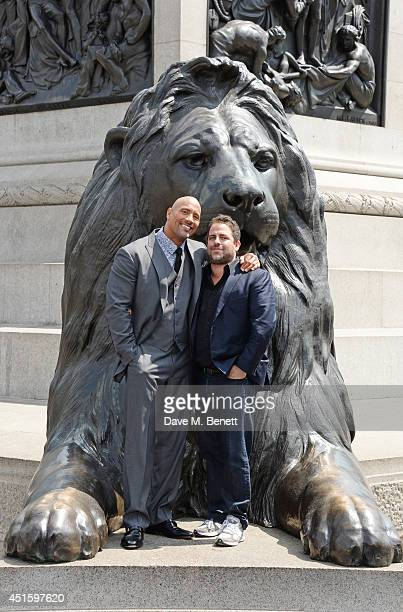 """Dwayne """"The Rock"""" Johnson and Brett Ratner attend a photocall for """"Hercules"""" at Nelson's Column in Trafalgar Square on July 2, 2014 in London,..."""