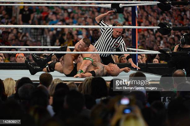 Dwayne ''The Rock'' Johnson and John Cena in action during WrestleMania XXVIII at Sun Life Stadium on April 1 2012 in Miami Gardens Florida