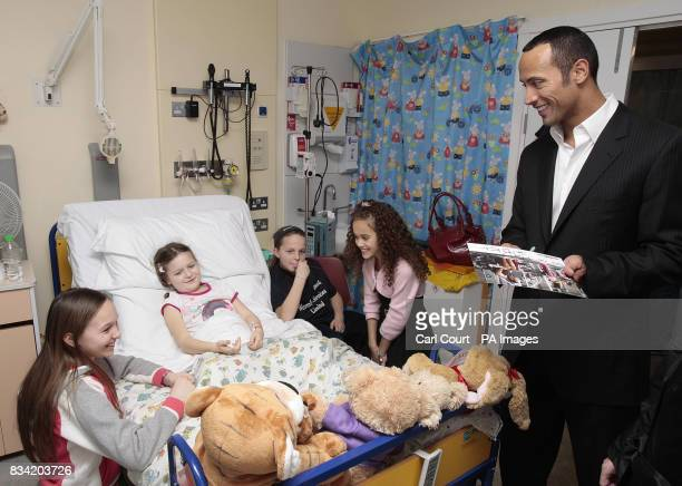 Dwayne ' The Rock' Johnson and Madison Pettis his costar in the new Disney film 'The Game Plan' visit 7 year old Lucy Long and her sisters Charlotte...