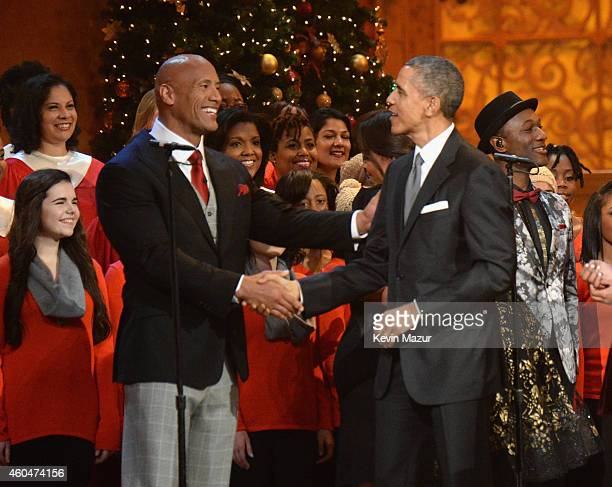 Dwayne The Rock Johnson and US President Barack Obama speak onstage at TNT Christmas in Washington 2014 at the National Building Museum on December...