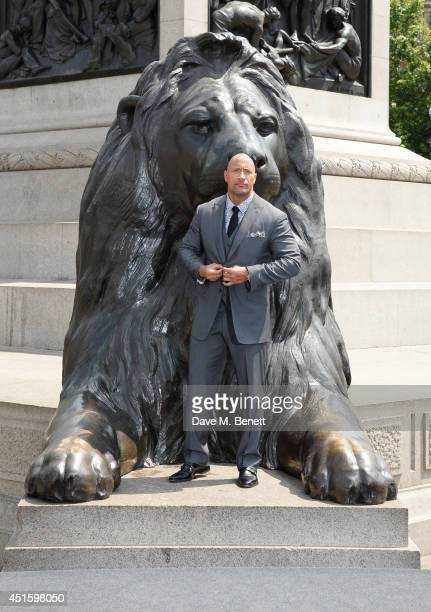 """Dwayne """"The Rock"""" Johnson attends a photocall for """"Hercules"""" at Nelson's Column in Trafalgar Square on July 2, 2014 in London, England."""