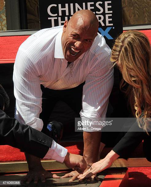 Dwayne 'The Rock' Johnson Immortalized With Hand And Footprint Ceremony held at TCL Chinese Theatre IMAX on May 19 2015 in Hollywood California