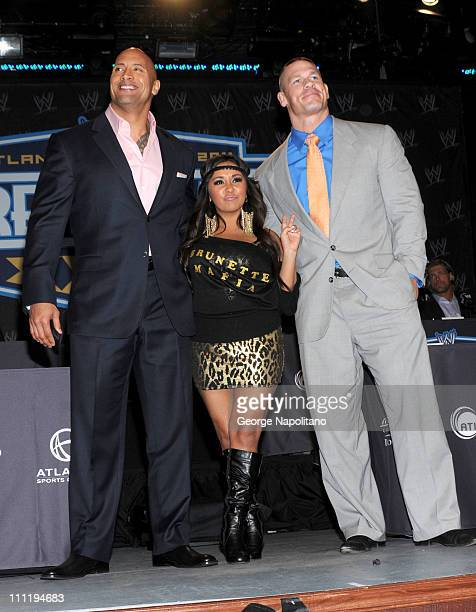Dwayne 'the Rock' Johnson Nicole 'Snooki' Polizzi and WWE Superstar John Cena attend the WrestleMania XXVII press conference>> at the Hard Rock Cafe...