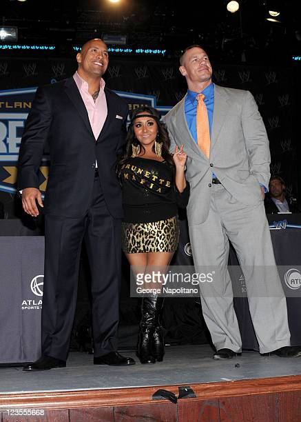 Dwayne the Rock Johnson Nicole Snooki Polizzi and WWE Superstar John Cena attend the WrestleMania XXVII press conference>> at the Hard Rock Cafe...
