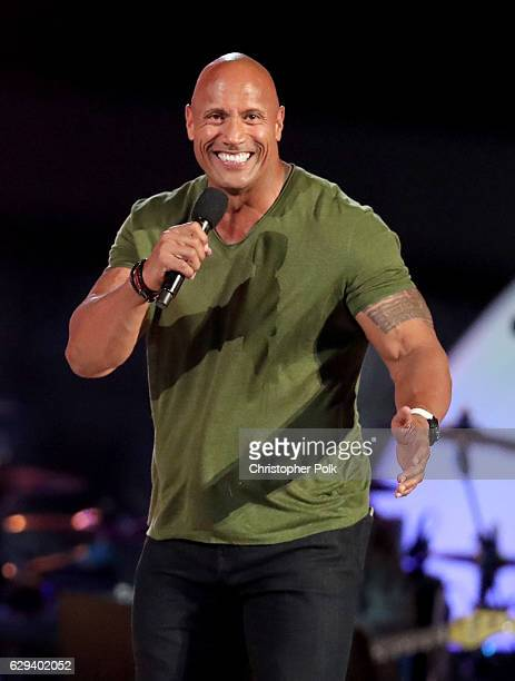 Dwayne 'The Rock' Johnson speaks onstage during 'Spike's Rock the Troops' event held at Joint Base Pearl Harbor Hickam on October 22 2016 in Honolulu...