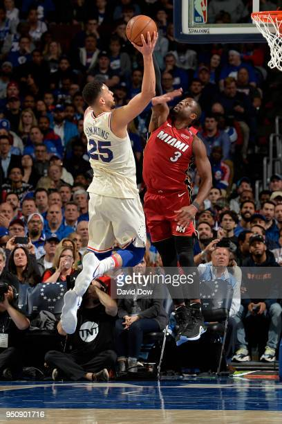 Dwayne Wade of the Miami Heat looks to block the shot of Ben Simmons of the Philadelphia 76ers in Game Five of Round One of the 2018 NBA Playoffs on...