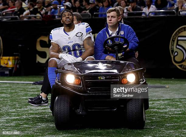 Dwayne Washington of the Detroit Lions is carted off the field during a game against the New Orleans Saints at the Mercedes-Benz Superdome on...