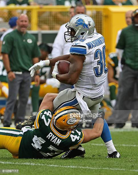 Dwayne Washington of the Detroit Lions is tackled by Jake Ryan of the Green Bay Packers at Lambeau Field on September 25, 2016 in Green Bay,...