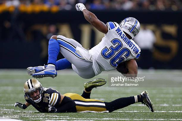 Dwayne Washington of the Detroit Lions is tackled by Sterling Moore of the New Orleans Saints during a game at the Mercedes-Benz Superdome on...