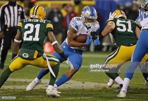 Dwayne Washington of the Detroit Lions runs between Ha Ha ClintonDix and Kyler Fackrell of the Green Bay Packers at Lambeau Field on September 28...