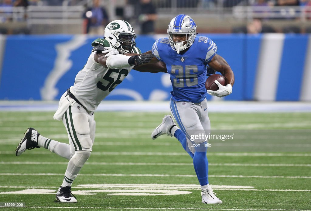 Dwayne Washington #36 of the Detroit Lions runs for a first down as Demario Davis #56 of the New York Jets makes the stop during the second quarter of the preseason on August 19, 2017 at Ford Field in Detroit, Michigan. The Lions defeated the Jets 16-6.