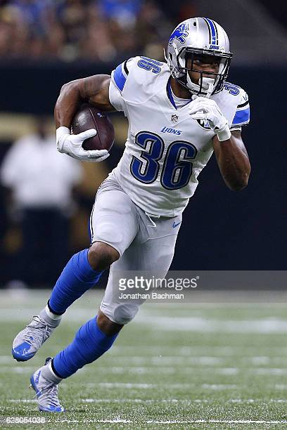 Dwayne Washington of the Detroit Lions runs with the ball during a game against the New Orleans Saints at the Mercedes-Benz Superdome on December 4,...
