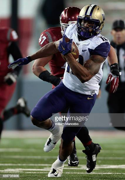 Dwayne Washington of the Washington Huskies carries the ball against the Washington State Cougars in the second half of the 107th Apple Cup at Martin...