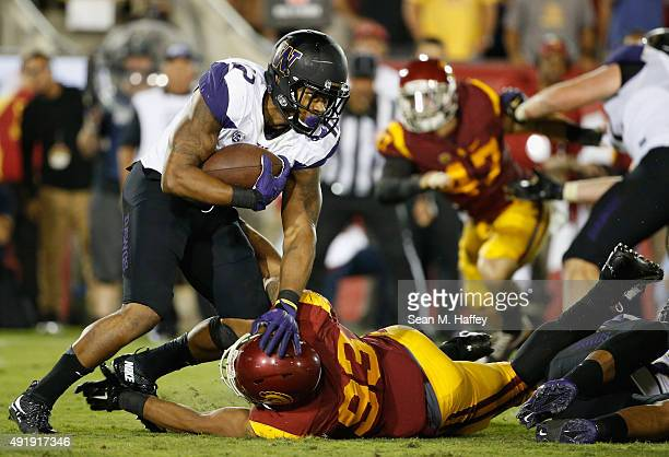 Dwayne Washington of the Washington Huskies runs past Greg Townsend Jr. #93 of the USC Trojans during the fourth quarter of a game at Los Angeles...