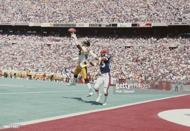 Dwayne Woodruff Defensive Back for the Pittsburgh Steelers intercepts the pass to Andre Reed Wide Receiver for the Buffalo Bills during their...