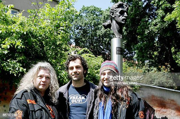 Dweezil Zappa son of late legendary guitarist Frank Zappa stand's between Zappa's widow Gail Zappa and daughter Diva Muffin Zappa as they pose in...