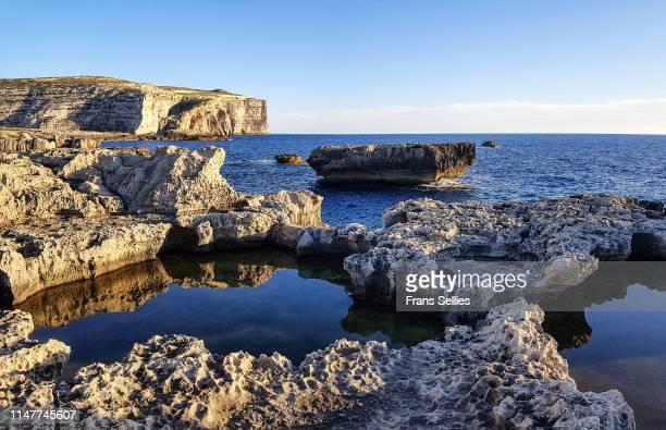 dwejra bay on gozo (malta) - dwejra stock-fotos und bilder